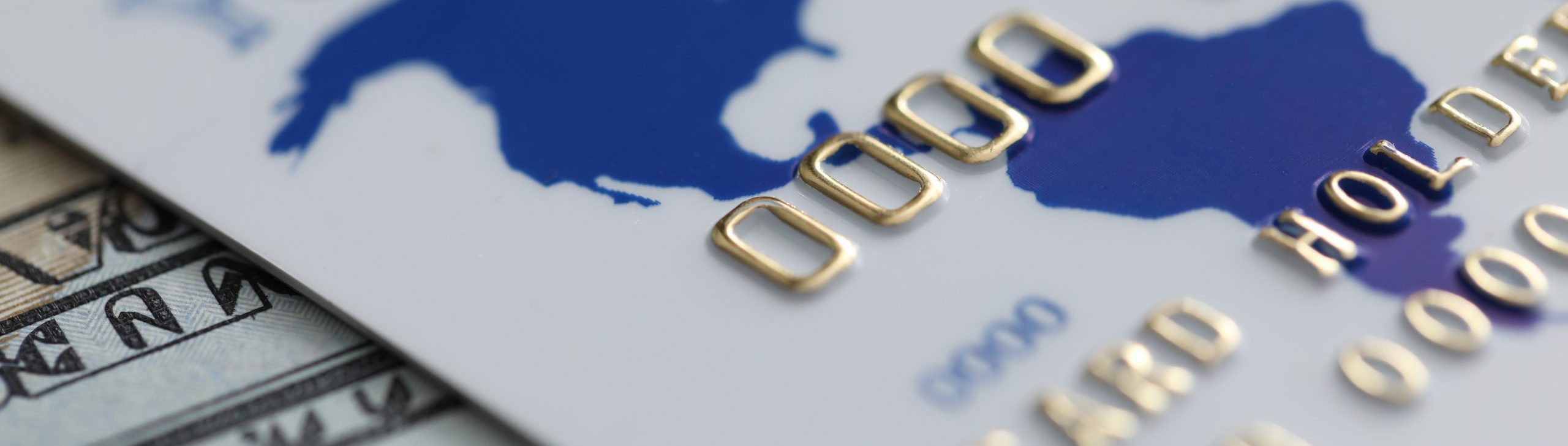 closeup of a credit card and American currency