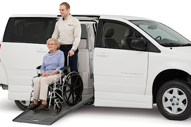 picture of a man pushing an elderly woman out of a van
