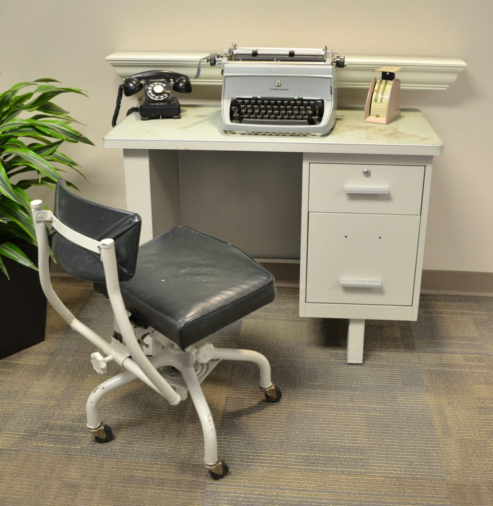Diagonal view of a desk and typewriter