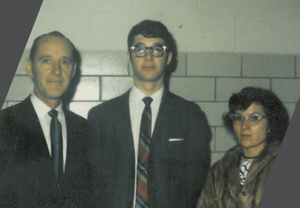 Jim and his parents facing the camera and smiling