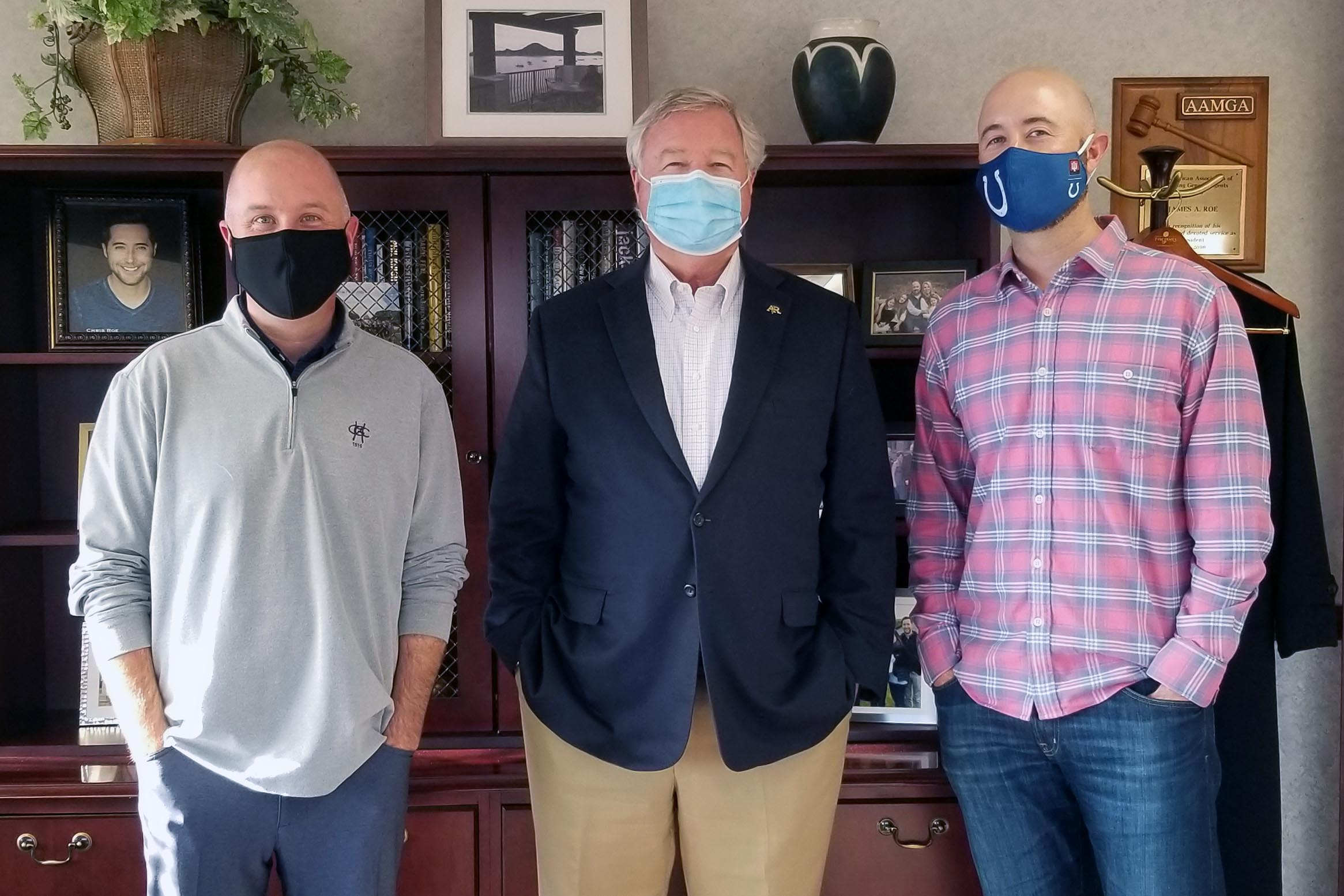 image of three Roes with masks on smiling at the camera